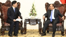 PM calls on Chinese investors to heed technology and the environment