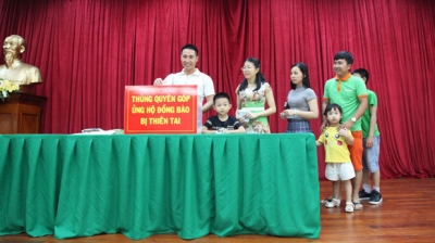 Vietnamese communities in Laos donate to support disaster victims