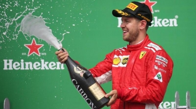 Motor racing: Vettel takes 50th win and F1 championship lead in Canada