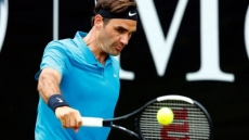 Federer battles hard for semi-final spot in Halle