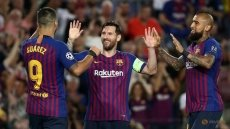 Messi hat-trick fires Barca to victory over PSV