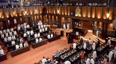 Sri Lankan parliament plunged into chaos after lawmaker presents no confidence vote against new PM