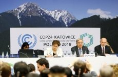 UN climate talks go into overtime as negotiators grapple with text