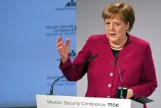 Merkel calls Russia a partner, urges global cooperation