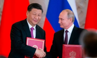 Xi, Putin meet in St. Petersburg
