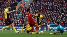 Salah strikes twice as Liverpool sink struggling Watford