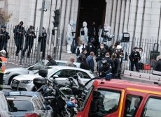 Nice attacker identified, France raises security threat level to highest