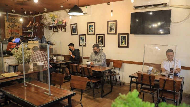 Indoor eating, museums and bus services reopen as Hanoi return to normal
